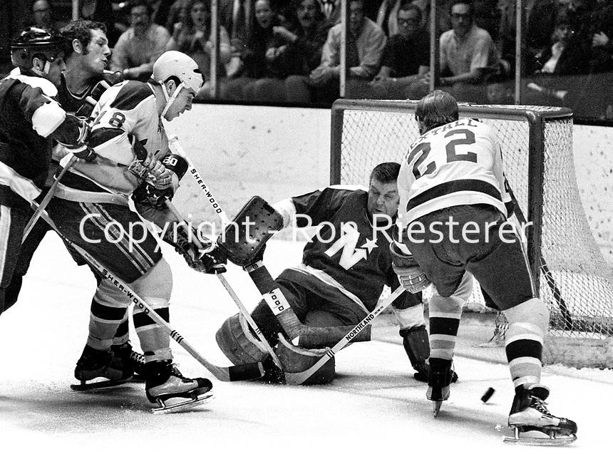 California Golden Seals attach North Star goalie Gump Worsley, Gary Croteau and Dennis Hextall ..(1971 photo/Ron Riesterer)