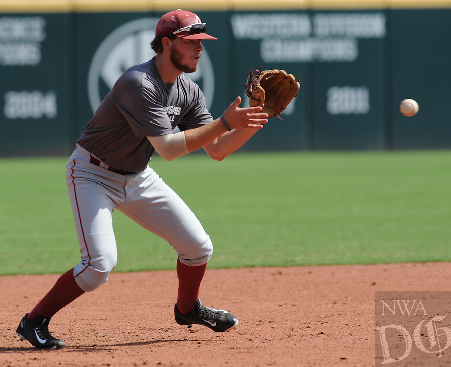 NWA Democrat-Gazette/ANDY SHUPE<br /> Arkansas' Nate Alberius fields a ball hit Friday, Sept. 9, 2016, during practice at Baum Stadium in Fayetteville.