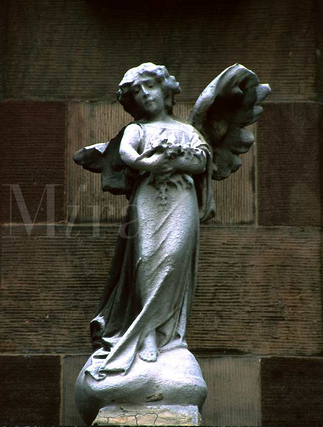A statue of an angel adorns a Catholic church