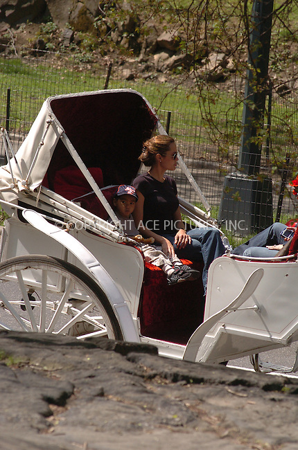 WWW.ACEPIXS.COM ** ** **NON-EXCLUSIVE!!! FEE MUST STILL BE NEGOTIATED BEFORE USE!!!***....NEW YORK, APRIL 26, 2005....Angelina Jolie and son Maddox Jolie take leave of their midtown hotel for a beautiful carriage ride through Central Park. Along the way, Maddox eats a giant pretzel and occasionally offers Angelina Jolie a bit now and again. Throughout the ride, Angelina is a completely attentive mother, making her son laugh and holding his extra pretzel bits.....Please byline: Philip Vaughan -- ACE PICTURES... *** ***  ..Ace Pictures, Inc:  ..Craig Ashby (212) 243-8787..e-mail: picturedesk@acepixs.com..web: http://www.acepixs.com