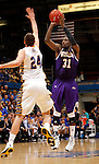 SIOUX FALLS, SD - MARCH 9:  Garret Covington #31 from Western Illinois spots up for a three pointer over Zach Horstman #24 from South Dakota State University in the second half of their quarterfinal game at the 2014 Summit League Tournament Sunday evening in Sioux Falls, SD. (Photo by Dave Eggen/Inertia)
