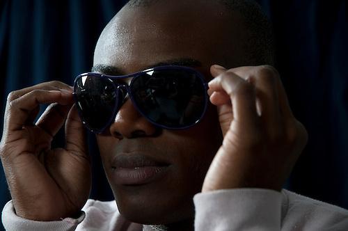Male portrait, modeled by Jah of York <br /> http://www.myspace.com/jahofyork <br /> Black male studio portrait