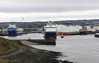 Oil Supply ship Solvik Supplier leaving Aberdeen harbour and being guided by the Pilot ship Sea Haven.