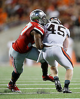 Ohio State Buckeyes linebacker Joshua Perry (37) collides with Virginia Tech Hokies fullback Sam Rogers (45) during the college football game between the Ohio State Buckeyes and the Virginia Tech Hokies at Ohio Stadium in Columbus, Saturday afternoon, September 6, 2014. The Virginia Tech Hokies defeated the Ohio State Buckeyes 35 - 21. (The Columbus Dispatch / Eamon Queeney)
