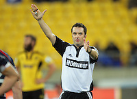 Referee Jonathon White signals a penalty during the Super 15 rugby match between the Hurricanes and Rebels at Westpac Stadium, Wellington, New Zealand on Saturday, 26 May 2012. Photo: Dave Lintott / lintottphoto.co.nz
