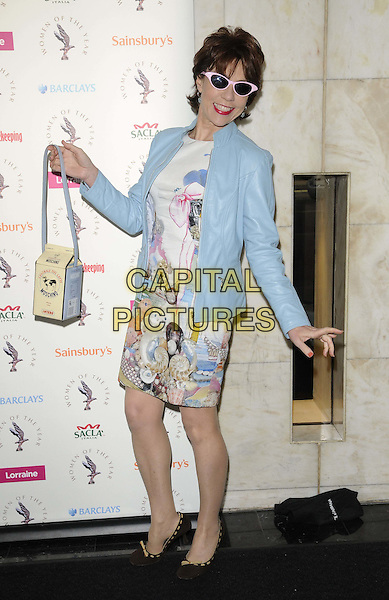 Kathy Lette .The Women Of The Year Lunch, Intercontinental hotel, Park Lane, London, England..October 17th, 2011.full length blue leather jacket white print dress bag sunglasses shades bag purse box.CAP/CAN.©Can Nguyen/Capital Pictures.