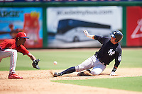 New York Yankees Luis Torrens (25) slides into second base as shortstop Jonathan Guzman (11) stretches for the throw during an Instructional League game against the Philadelphia Phillies on September 27, 2016 at Bright House Field in Clearwater, Florida.  (Mike Janes/Four Seam Images)
