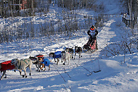 Saturday, February 24th, Knik, Alaska.  Jr. Iditarod musher Michael Owens on the trail shortly after leaving the Knik start
