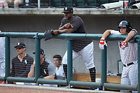 Birmingham Barons hitting coach Charlie Poe (44) watches the action from the dugout during the game against the Pensacola Blue Wahoos at Regions Field on July 7, 2019 in Birmingham, Alabama. The Barons defeated the Blue Wahoos 6-5 in 10 innings. (Brian Westerholt/Four Seam Images)