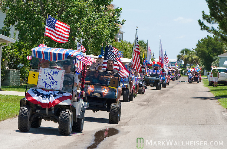The 4th of July Independence Day celebration golf cart parade snakes through The Village at Shell Point in Wakulla County, Florida