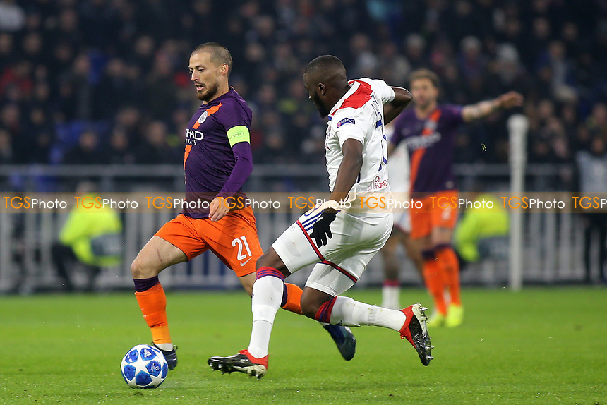 David Silva of Manchester City bursts through the Lyon defence during Lyon vs Manchester City, UEFA Champions League Football at Groupama Stadium on 27th November 2018