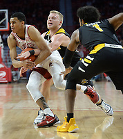 NWA Democrat-Gazette/ANDY SHUPE<br /> Arkansas guard Jalen Harris drives to the lane Saturday, Nov. 30, 2019, as he is pressured by Northern Kentucky guards Tyler Sharpe (center) and Adham Eleeda during the second half of play in Bud Walton Arena. Visit nwadg.com/photos to see more photographs from the game.