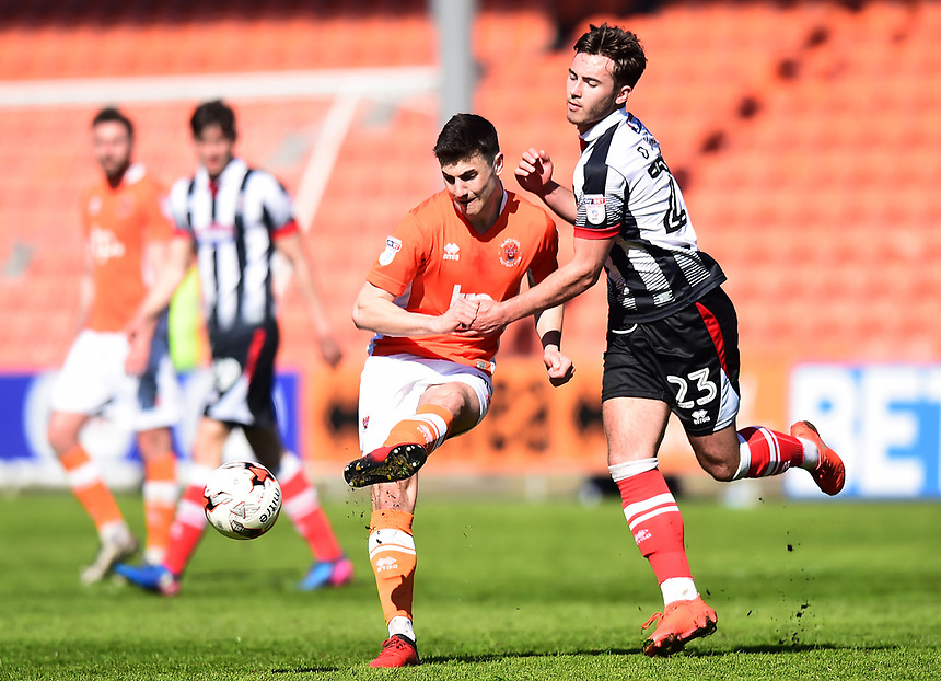 Blackpool's Jordan Flores competes with Grimsby Town's Dan Jones<br /> <br /> Photographer Richard Martin-Roberts/CameraSport<br /> <br /> The EFL Sky Bet League Two - Blackpool v Grimsby Town - Saturday 8th April 2017 - Bloomfield Road - Blackpool<br /> <br /> World Copyright &copy; 2017 CameraSport. All rights reserved. 43 Linden Ave. Countesthorpe. Leicester. England. LE8 5PG - Tel: +44 (0) 116 277 4147 - admin@camerasport.com - www.camerasport.com
