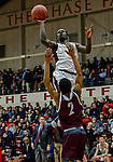 WEST HARTFORD, CT. 15 March 2018-031518BS24 - Raheem Solomon (11) from Sacred Heart shoots over Corey McKeithan (2) from Windsor at the Div I semi-finals between Sacred Heart vs Windsor at University of Hartford on Thursday evening. Sacred Heart won in a thriller 59-58 over Windsor and advances to the finals at Mohegan Sun. Bill Shettle Republican-American