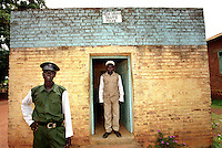 Traffic police outside their office at the main junction in Yei town.  Although there is hardly any traffic, the administrative wing of the SPLA (Sudanese Peoples Liberation Army) ensures the provision of public services.  'New Sudan' on the sign is the name given by the SPLA to the future independent South Sudan.