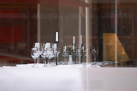 a table with white starched table cloth and glasses seen through the window. The gastronomic restaurant Tva Bröder, Two Brothers, on Sundstorget. Helsingborg, Skane, Scania. Sweden, Europe.