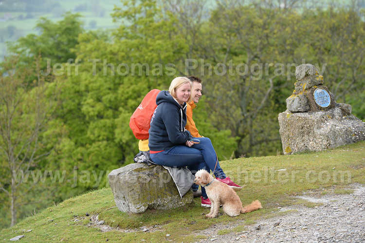 Competitors climb the challenging iconic and notorious 6km 10% stretch of road namely The Tumble during the Wales Velothon 2016 140km route cycling race. Spectators watching the race. The dog prefers to enjoy the scenery from the Blorenge/Tumble. <br />