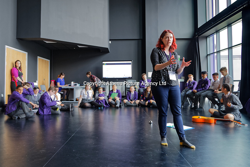 Pictured: Creative Director for Operasonic, Rhian Hutchings speaks to Year 9 and 10 pupils as they rehearse Wales National Opera's Rhondda Rips It UP at of John Frost School in Newport, Wales, UK. Thursday 11 May 2018<br /> Re: Welsh National Opera is creating a new musical hall-style all female piece for the summer called Rhondda Rips It Up. It's about the life of suffragette Lady Rhondda with songs inspired by suffragette slogans. Opera opening next month in Newport, south Wales, where Lady Rhondda blew up a postbox with a home-made bomb and went to jail for.