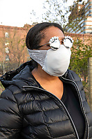 """New York, New York City, during the time of Coronavirus. People were out and about on Easter Sunday in New York City, being careful to walk at a social distance. Dr. Austin works as a dentist between Michigan and Brooklyn, although her work is now on pause. """"It's been so difficult to get face masks here. My mom freaked out when she heard I didn't have one. She went on line and googled how to make one. This is what she sent me. It's made from a bra."""""""