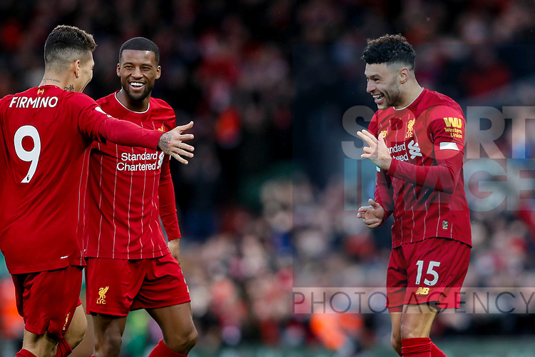 Alex Oxlade-Chamberlain (r) of Liverpool celebrates scoring the first goal of the game during the Premier League match at Anfield, Liverpool. Picture date: 1st February 2020. Picture credit should read: James Wilson/Sportimage