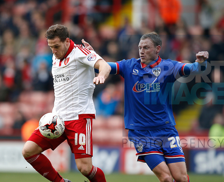 Billy Sharp of Sheffield Utd tussles with Brian Wilson of Oldham Athletic during the Sky Bet League One match at The Bramall Lane Stadium.  Photo credit should read: Simon Bellis/Sportimage