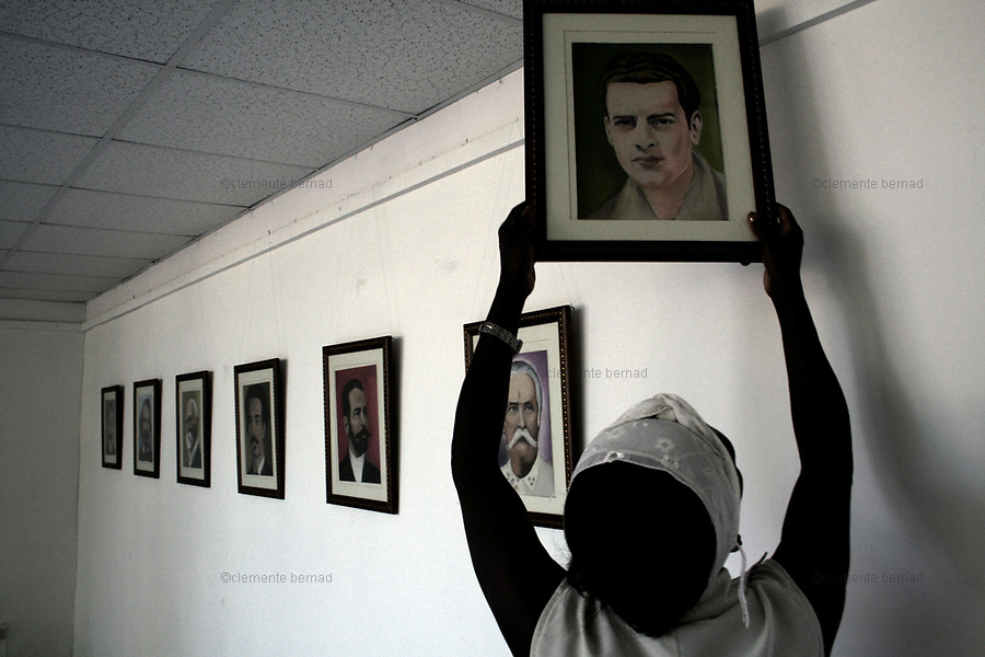 Havana (Cuba). September 2006..Portrait exhibition by one of the Cuban five. The Cuban Five are Gerardo Hernández, Antonio Guerrero, Ramón Labañino, Fernando Gonzáles, and René Gonzáles. After being arrested in Miami, Florida in September 1998, they were indicted by the U.S. government on 26 different counts ranging from using false identification to espionage and conspiracy to commit murder. In June 2001, they were convicted of all 26 counts by a U.S. federal court in Miami and in December sentenced to varying terms in maximum-security prison: two consecutive life terms for Hernández, life for Guerrero and Labañino, 19 years for Fernando Gonzáles, and 15 years for René Gonzáles..