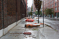 Debris in the New York neighborhood of Chelsea from the high winds of Hurricane Sandy is seen on Tuesday, October 30, 2012. Hurricane Sandy roared into New York disrupting the transit system and causing widespread power outages. Con Edison is estimating it will take four days to get electricity back to Lower Manhattan. (© Frances M. Roberts)
