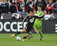 DC United midfielder Andy Najar (14) shields the ball against Seattle Sounders midfielder Alvaro Fernadez (15).  DC United defeated The Seattle Sounders 2-1, at RFK Stadium, Wednesday  May 4, 2011.
