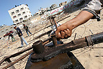 Palestinian workers extract iron from the rubbles of Shihab Balas hotel and Al-Jazeera hotel which destroyed during Israel's 22-days military assault over Gaza Strip , in Gaza City on Oct. 13,2010. These iron are used to rebuild a new houses because Israel prevents entering the iron into the Gaza Strip . Photo by Mohammed Asad