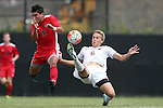 30 August 2015: Elon's Samuel McBride (6) clears the ball from Saint Mary's Gerardo Mendoza (11). The Elon University Phoenix played the Saint Mary's College Gaels at Koskinen Stadium in Durham, NC in a 2015 NCAA Division I Men's Soccer match. Elon won the game 1-0.