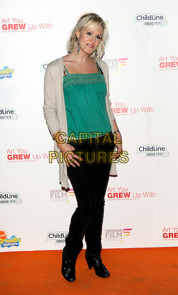 REBECCA WILCOX .Attending the charity auction of SpongeBob SquarePants Artwork, London, England, UK, .21st January 2010..full length green top cardigan cream longline  black jeans boots .CAP/CJ.©Chris Joseph/Capital Pictures.