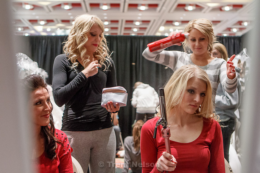 Trent Nelson  |  The Salt Lake Tribune.Jamie Barkdull, Taryn Tolman, Robbie Bahr and Katie Hascall (standing at right) prepare to model for a fashion show at the Bridal Showcase Saturday January 5, 2013 at the Salt Palace Convention Center in Salt Lake City.