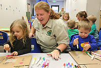 NWA Democrat-Gazette/DAVID GOTTSCHALK Beckie Moore (center), wildlife interpreter Turpentine Creek Wildlife Refuge, helps decorate boxes Friday, April 12, 2019, with Kodah Davis (left) and Connor Ledford, both pre-school students at The Goddard School Fayetteville. Students at the school were participating in Root for the Earth Week with a Save the Animal Save the Earth theme. Representatives from the wildlife refuge gave a presentation on bears, tigers and lions and worked with the students on creating the enrichment toys for the animals.