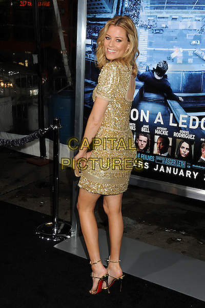Elizabeth Banks.L.A. Premiere of  'Man on a Ledge' held at The Grauman's Chinese Theatre in Hollywood, California, USA..January 23rd, 2012 .full length dress gold silver beads beaded sequins sequined looking over shoulder back behind rear.CAP/ADM/BP.©Byron Purvis/AdMedia/Capital Pictures.
