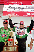 Crew chiefJimmy Makar(left) and Bobby Labonte celebrate theri 2000 Winston Cup Championship after the Pennzoil 400 at Homestead-Miami Speedway in November 2000. (Photo by Brian Cleary)