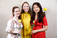 Contestants Melanie Laurent of France, left, Lise Vandersmissen of Belgium and Nicolette Chin of Singapore pose at a photo booth during the opening reception and dinner of the 11th USA International Harp Competition at Indiana University in Bloomington, Indiana on Wednesday, July 3, 2019. (Photo by James Brosher)