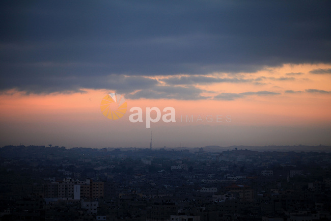 A picture taken at Sunrise on August 11, 2014 shows the Gaza city. Palestinian and Israeli negotiators on Sunday said they had accepted an Egyptian proposal for a new 72-hour truce with Israel, clearing the way for a possible resumption of talks on a long-term cease-fire arrangement in the Gaza Strip. Photo by Mohammed Othman