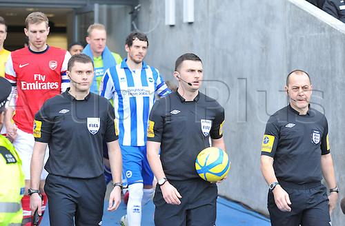 26.01.2013 Brighton, England. Referee Michael Oliver with Assistant refs Ronald Ganfield and Simon Bennett before the start of  the FA Cup Fourth Round game between Brighton and Hove Albion and Arsenal from the Falmer Stadium.