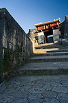 """Photo shows Zuisenmon gate inside the grounds of Shuri-jo Castle  in Naha, Okinawa Prefecture, Japan, on June 24, 2012. Zuisenmon, which means """"splendid and auspicious spring,"""" takes its name from the Ryuhi"""" spring just in front of it. Photographer: Robert Gilhooly"""