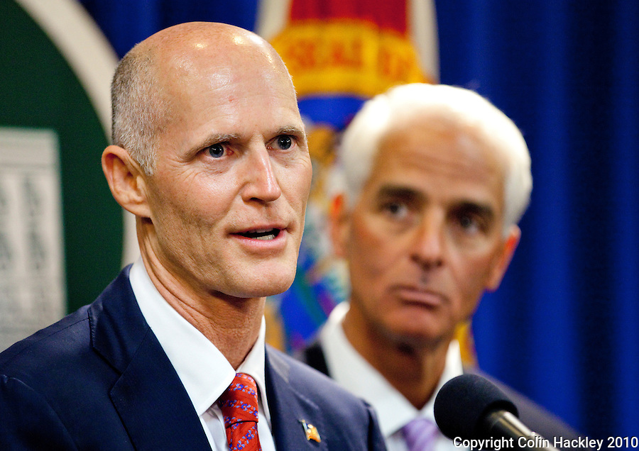 TALLAHASSEE, FLA. 11/9/10-SCOTT-CRIST 110910 CH-Governor-elect Rick Scott, left, and Gov. Charlie Crist during a news conference Tuesday at the Capitol in Tallahassee...COLIN HACKLEY PHOTO