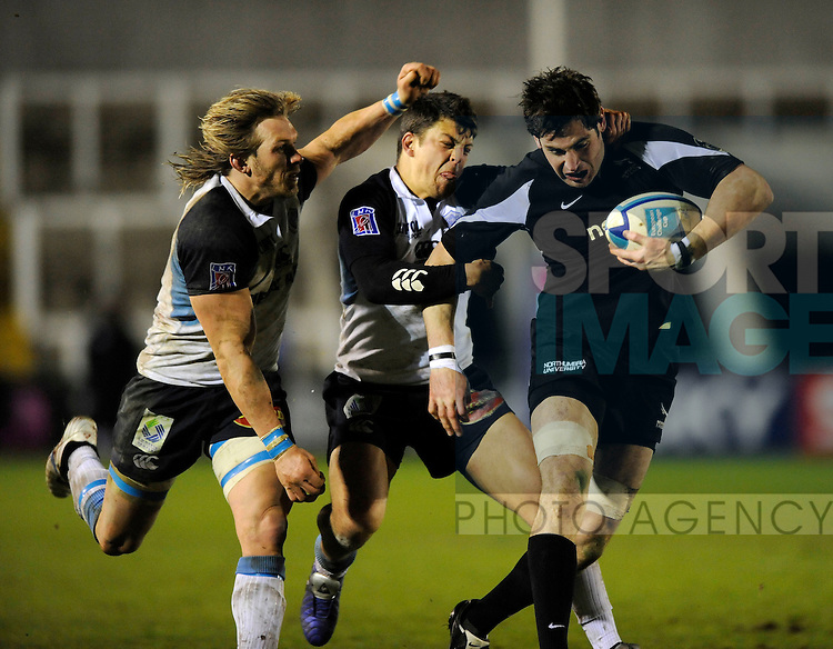 Newcastle's Brent Wilson (R) is tackled by Castres' Lionel Mazars (C) and Gerhard Vosloo.