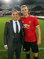 Brendan Rodgers (L) of Swansea Legends with Manchester United player during the Swansea Legends v Manchester United Legends at The Liberty Stadium, Swansea, Wales, UK. Wednesday 09 August 2017