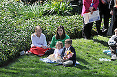 Washington, DC - April 15, 2008 -- An unidentified family sits on the grass on the South Lawn as they listen to Pope Benedict XVI make remarks at the White House in Washington, D.C. on Wednesday, April 16, 2008.  .Credit: Ron Sachs / CNP.(RESTRICTION: NO New York or New Jersey Newspapers or newspapers within a 75 mile radius of New York City)