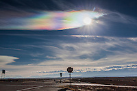 Clouds in the crisp cold sky refracted the sun and created rainbow colored patterns over Interstate 25 between Pueblo and Trinidad.
