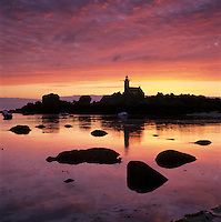 France, Brittany, near Brignogan Plage: Pointe de Pontusval lighthouse at dawn