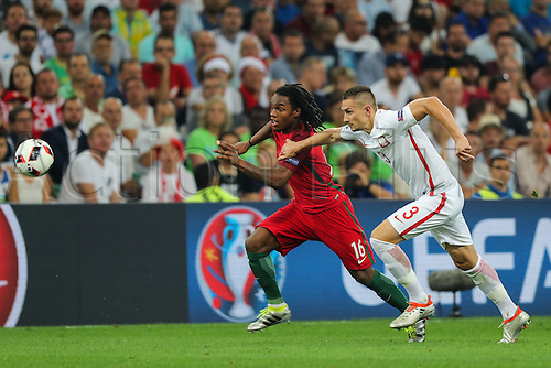30.06.2016. Marseille, France. UEFA EURO 2016 quarter final match between Poland and Portugal at the Stade Velodrome in Marseille, France, 30 June 2016.   Artur Jedrzejczyk (POL) is outpaced by Renato Sanches (POR)