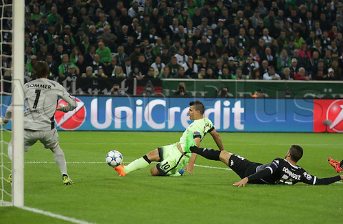 30.09.2015. Moenchengladbach, Germany.  UEFA Champions League, Borussia Moenchengladbach - Manchester City FC . Yann Sommer (Borussia Moenchengladbach) challenges Sergio Aguero (Manchester City), watched by Alvaro Dominguez (Borussia Moenchengladbach)