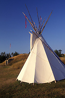 AJ0458, North Dakota, Teepee and earth lodge are exhibited at On-a-Slant Mandan Indian Village at Fort Abraham Lincoln State Park in Mandan.