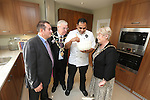 Anand George from Purple Poppadom who will be demonstrating his cooking skills at the Newport Food Festival giving a few tips to Mayor of Newport Councillor Cliff Suller, his wife Christine and Redrow Homes Managing Director Stuart Rowlands during a visit to the Mon Bank development.<br /> 25.09.13<br /> <br /> &copy;Steve Pope-FOTOWALES