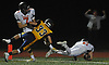 Aidan LaRock #7 of Babylon, left, makes a block for teammate Frank Vano #2, who dives into the end zone after making a catch for a touchdown of approximately 41 yards in a Suffolk County Division IV varsity football game against host Shoreham-Wading River High School on Friday, Oct. 20, 2017.